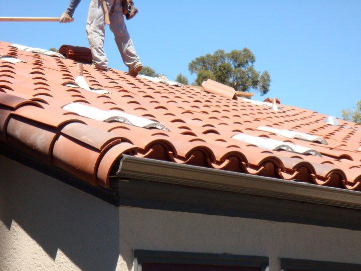Replacing a roof is an ideal time to make related improvements to home energy efficiency. Photo: R E Roofing and Construction, Inc. (2014)