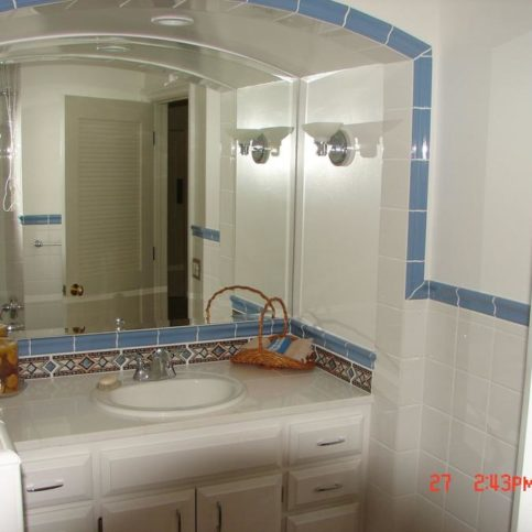 This Bathroom Renovation Project Features Tile, Standard Plumbing And Light  Fixtures, And Inlaid Tile Backsplash.
