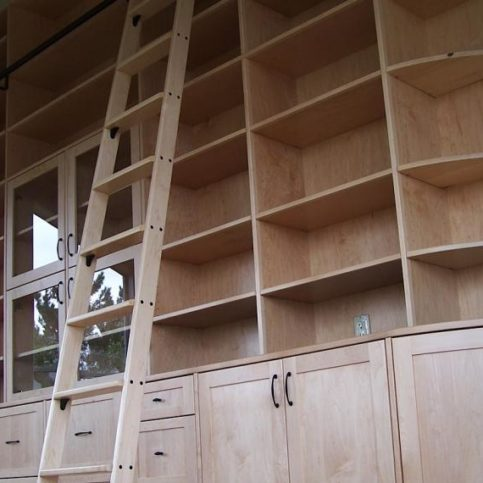 Maple Library With Custom Ladder And Curved End Cabinet.