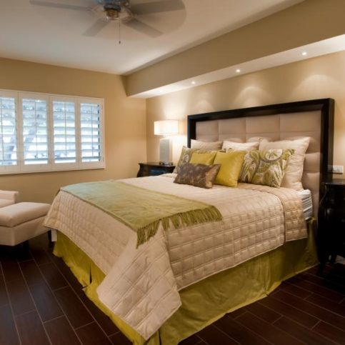 This Contemporary Master Bedroom Features Custom Bedding And A Headboard