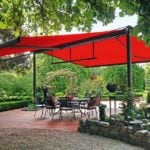 red retractable awning in backyard