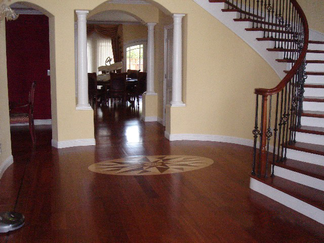 dark hardwood floor with design in center