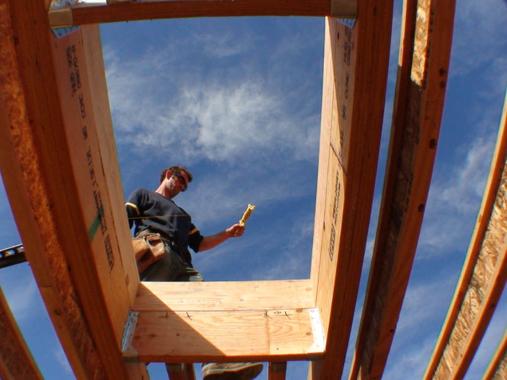 construction worker walking on wood framing