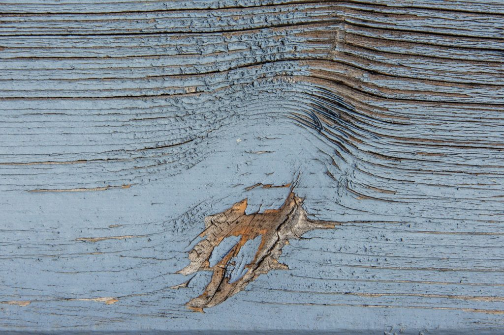 worn paint on wood