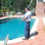 pool service tech at work