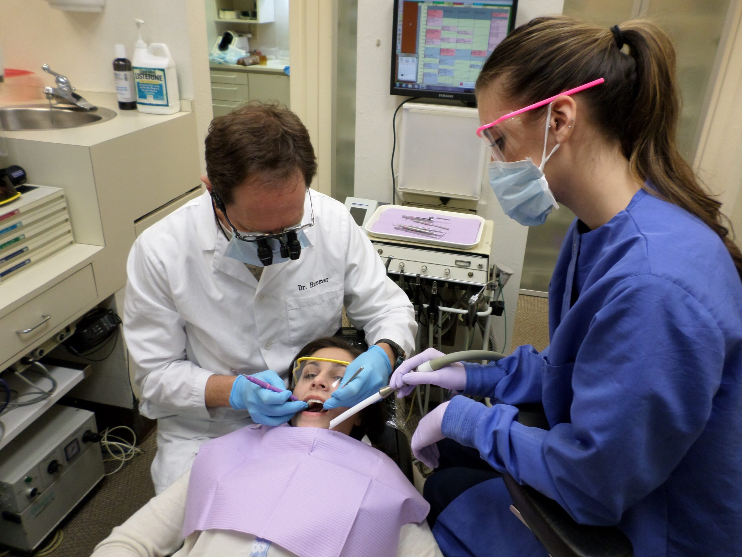 dentist and hygienist caring for a patient