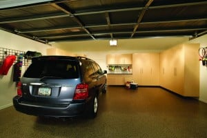Proactive organizational improvements can transform your garage from a chaotic catch-all to a fully functional space. Photo: PremierGarage (2014)
