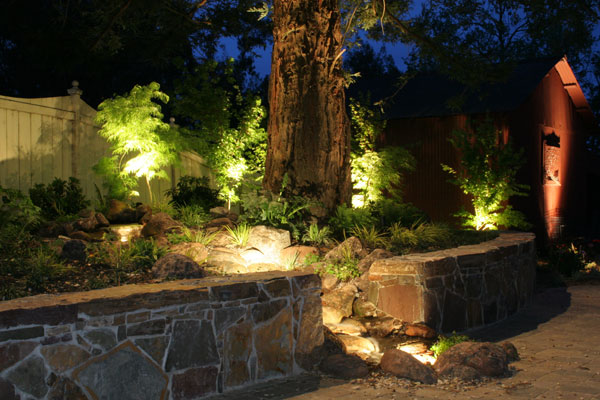 When designing landscape lighting, remember that the overall effect is more important than the light fixtures themselves. Photo: Gill Landscape Inc. (2015)