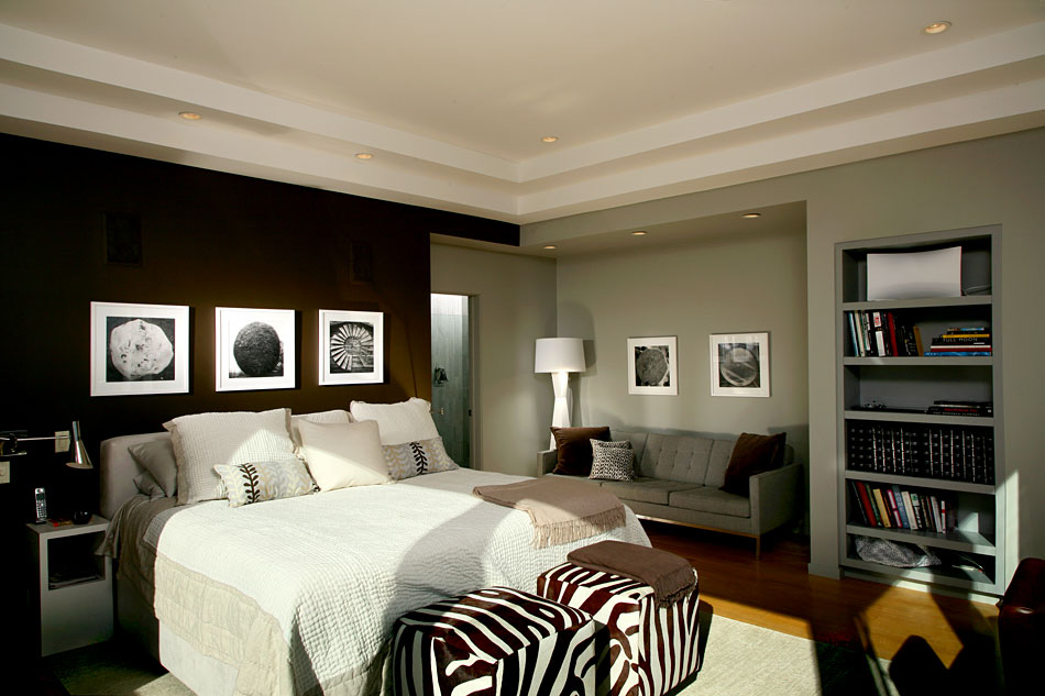 A bedroom with a black and white and zebra design