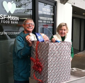 Marcia Custer, Marin General Manager and a volunteer inspect our food donation.