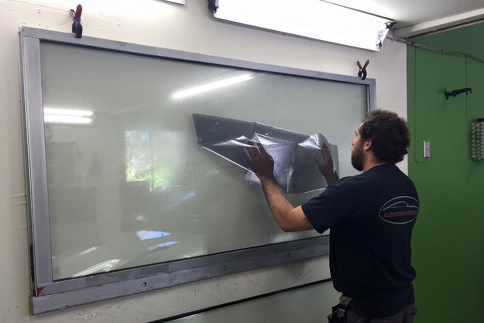 Thanks to innovations in window film technology, today's drivers can get the functional benefits of a dark tint without the darkening aesthetic. Photo: Perfect Darkness Tint (2016)
