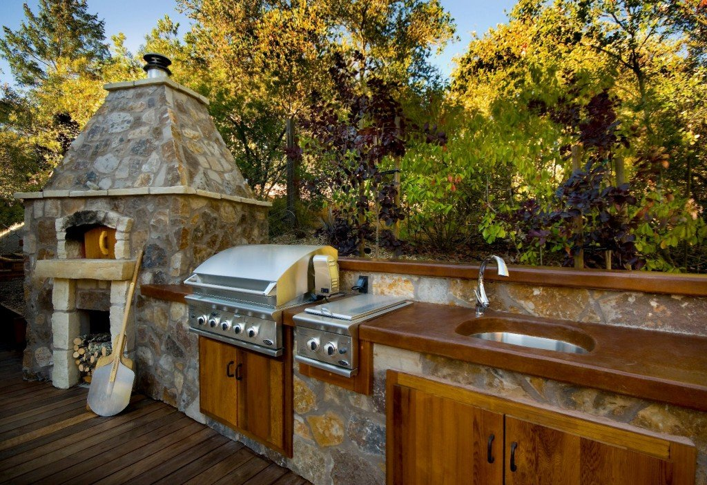 If you enjoy dining alfresco, an outdoor kitchen can double your pleasure by allowing you to cook outside as well. Photo: Riptide Construction, Inc. (2016)
