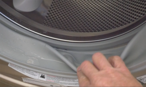 To avoid mildew issues with your front-loading washing machine, clean the rubber door seal on a regular basis. Photo: HPS Palo Alto, Inc. (2016)