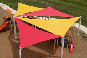 shade sails over a playground