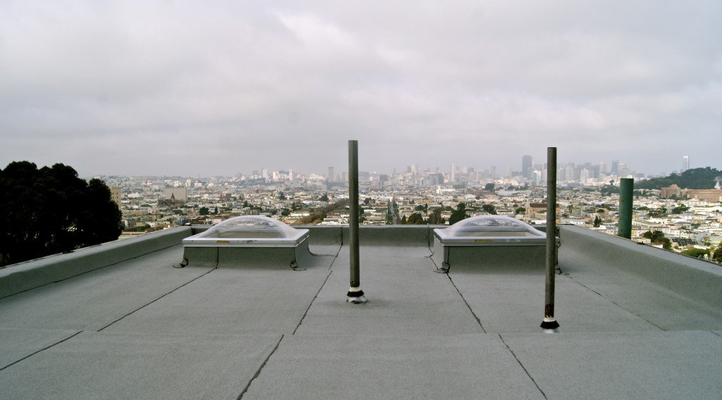 pipe jacks on roof overlooking city